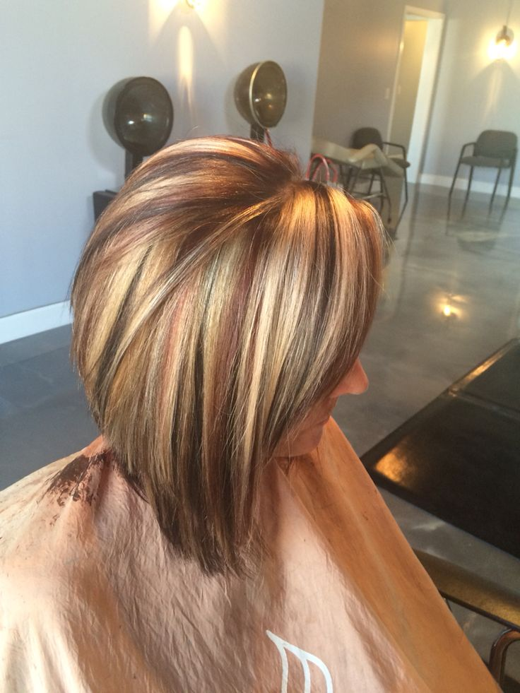 Beautiful slices red blonde and brown. Long swing bob cut. #aloxxi color.