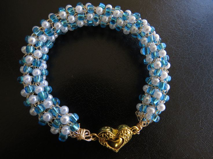 bracelet crocheted in wire with seed beads and pearl beads