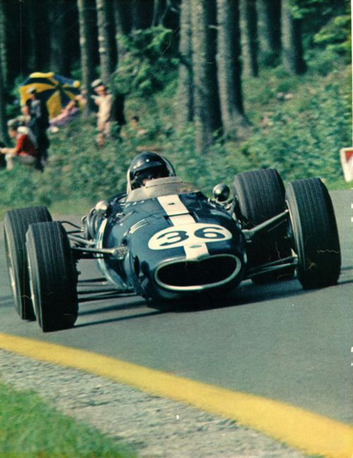 """Dan Gurney, Eagle-Weslake, Belgium Grand Prix 1967.  """"History in the making:  Called """"one of the most beautiful Grand Prix cars ever built"""", the Eagle / Gurney - Weslake V12 number '36' is racing through the Ardennes Forest to win the Grand Prix of Belgium in 1967, making this the first, and so far, only victory for an American in an American Grand Prix car in the modern era."""""""