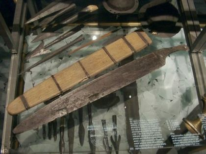 Single-edged sword with reconstructed scabbard from Ejsbøl or Illerup