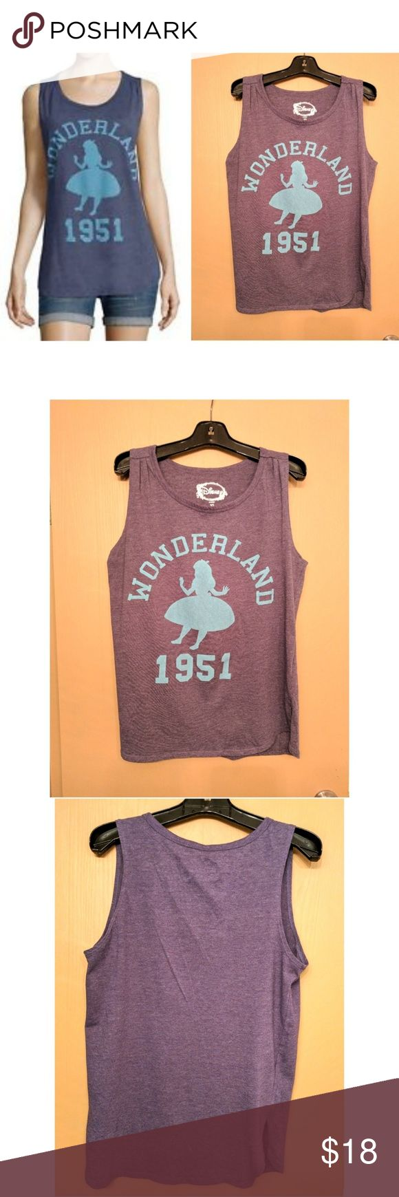 """🎀NEW Wonderland 1951 Disney Tanktop This awesome Disney classic Alice in Wonderland tank is perfect for dressing on any occasion! Navy blue cotton material with light blue Alice outline and Wonderland 1951. Size XL, armpit to armpit measures 19.5"""" unstretched, 27.5"""" length. Slits in sides, back comfortably covers waist, longer than front. Dress with leggings, jeans, shorts... Possibilities are endless! NWOT UNUSED NO DAMAGES. Grab yours for less and look great in this awesome tanktop…"""