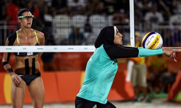 Doaa Elgobashy (R) of Egypt scoops the ball during the women's Beach Volleyball preliminary pool D game between Ludwig/Walkenhors of Germany and Elghobashy/Nada of Egypt the Rio 2016 Olympic Games at the Beach Volleyball Arena on Copacabana Beach in Rio de Janeiro, Brazil, 07 August 2016.