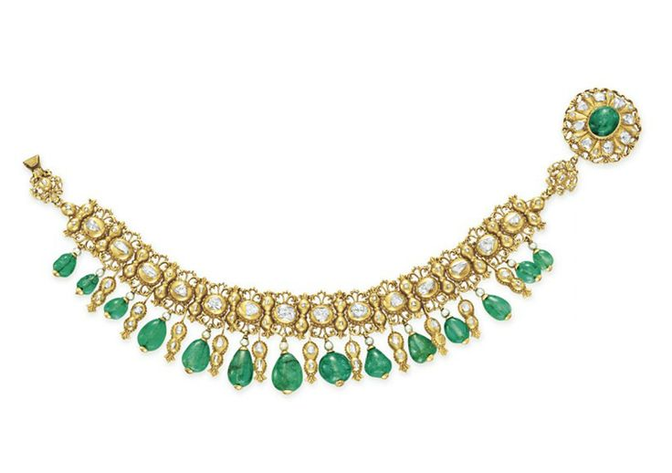 AN ANTIQUE EMERALD, DIAMOND AND GOLD NECKLACE  The front suspending a graduated fringe of emerald beads with rose-cut diamond and sculpted gold spacers, joined by seed pearls to the openwork rose-cut diamond and sculpted gold band, to the cabochon emerald and rose-cut diamond plaque clasp, mounted in gold, late nineteenth century, 13 ins.