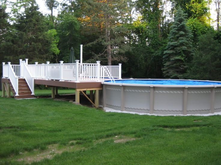 Possibly a pool deck like this but with a snake proof for Above ground pool decks attached to house