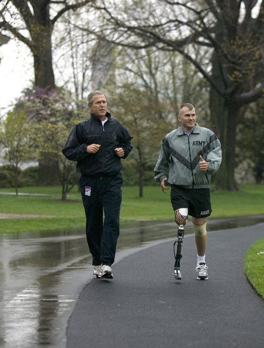 This iconic photograph shows then President George W. Bush jogging with wounded SSgt Mike McNaughton in 2004. Mike is a native of Denham Springs, Louisiana who supports our purple heart veterans through causes such as Blue Star Moms and Ride 2 Recovery. He works for the State of Louisiana Department of Veterans Affairs.  He can do it all!