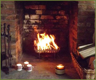 A roaring log fire in a country cottage fireplace  England and English style  Cottage