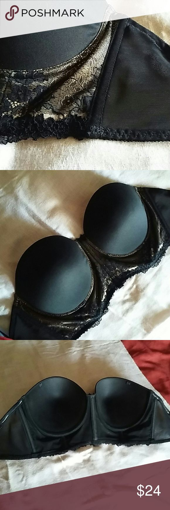 34F / 34G Strapless Bra Worn once. Cup size is on the big side for a 34F. Band size is accurate.  This is a beautiful bustier. Great support!  Selling because the cup size is just a little too big. Would be perfect for a full 34F or small 34G. Black molded cups and black lace over goldish-nude.  Does come with straps still in the package. This is in like new condition. I did cut out the tag, but it said 34F for the size. Panache Intimates & Sleepwear Bras