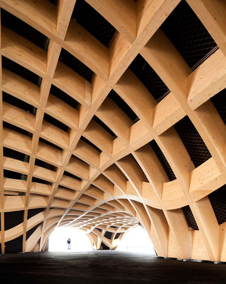 Milan Expo 2015: French pavilion. Anouk Legendre of Studio X-TU, designed the French Pavilion in partnership with Atelien Architecture. It features a rippling ceiling of glulam French spruce which mimics the contours of the land, shaping inverted hills and valleys to enclose a 'covered market' of 3500sqm. Photography:(copyright) X-TU - Andrea Bosia