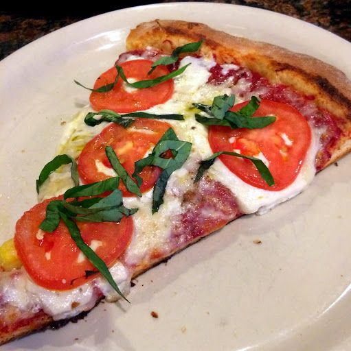 Margherite with olive oil, Roma tomatoes, mozzarella, basil. At Zio's Pizzeria in Omaha.