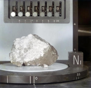 This the Genesis Rock, a lunar rock collected during the Apollo 15 mission. Scientists announced that traces of water have been detected within  the sample. The presence of water in such an old rock contradicts long held theories of the Moon's formation - that it formed in a giant collision between Earth and a Mars sized object. A Moon formed in such a way would have been mostly molten during its early life, and liquid water would have been impossible.