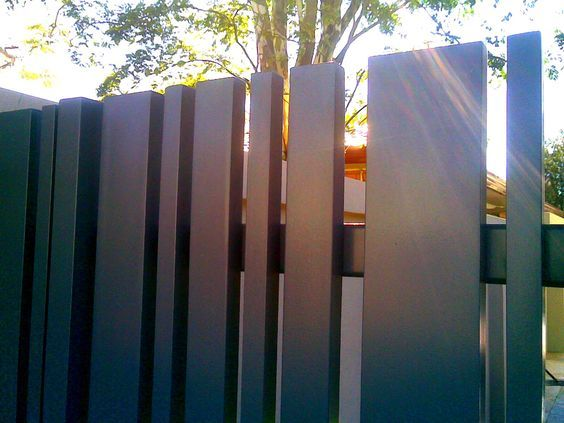 vertical metal fence- have fun with spacing to add whimsy! Paint black to still look upscale