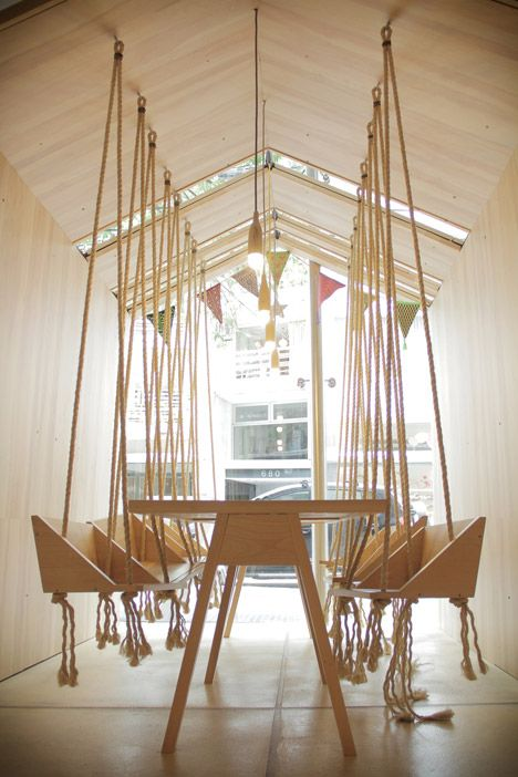 This cafe features wooden swing seats for both adults and children. barefootstyling.com