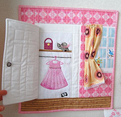 How about a unique way of using scraps of your child's clothing and incorporating it with a scene in their life - for a baby book for their children