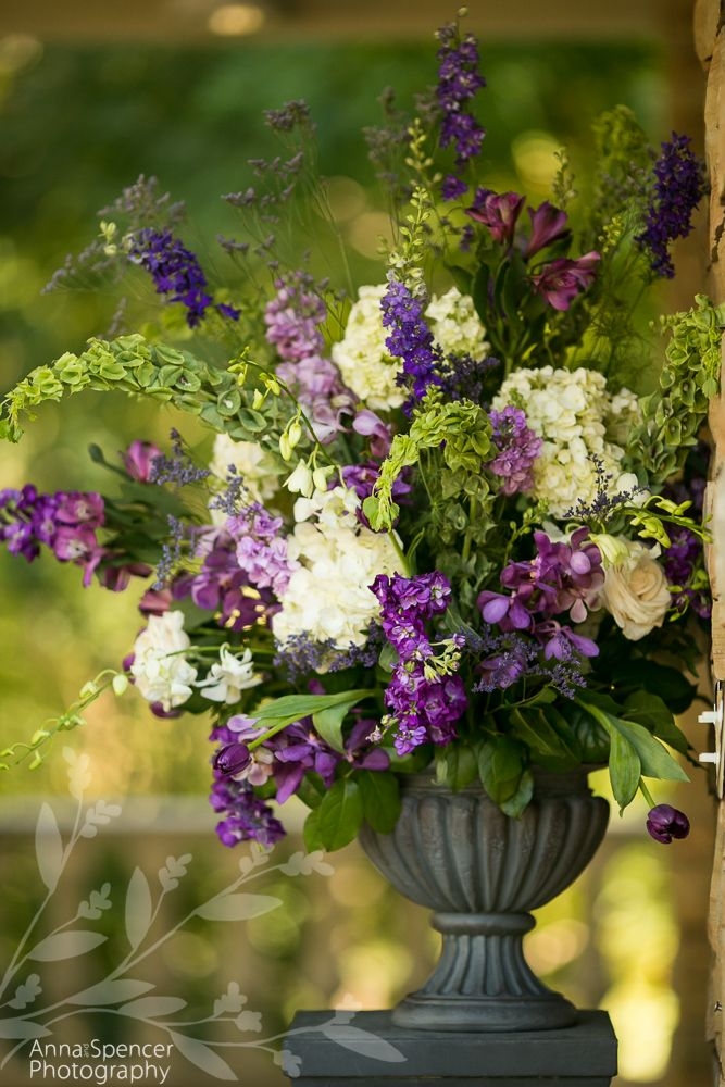 Anna and Spencer Photography, Atlanta Wedding Photographers. Wedding Ceremony Flowers: purple, white, and green.