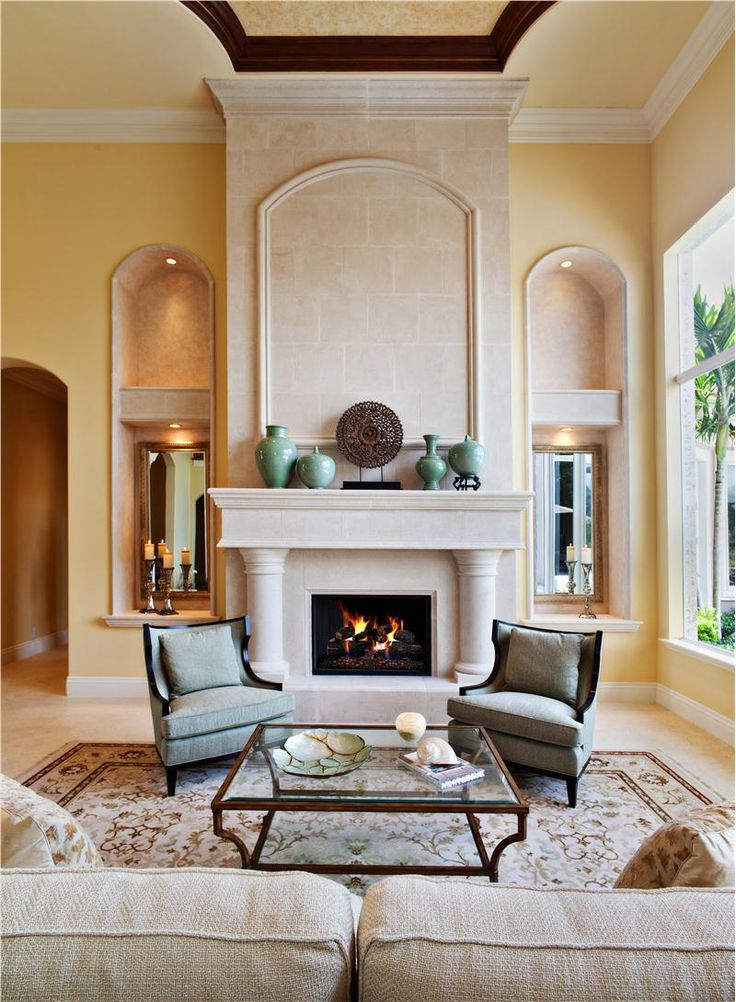 Best 20 mediterranean living rooms ideas on pinterest for Mediterranean fireplace designs