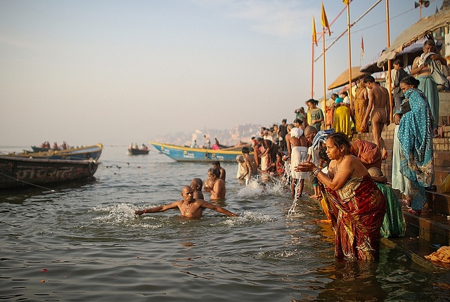Holy Varanasi (India). 'Everyone in Varanasi seems to be dying or praying or hustling or cremating someone or  swimming or laundering or washing  buffaloes in the city's sewage-saturated Ganges. The goddess river will clean away your sins and help you escape from that tedious life-and-death cycle.' http://www.lonelyplanet.com/india/uttar-pradesh/varanasi
