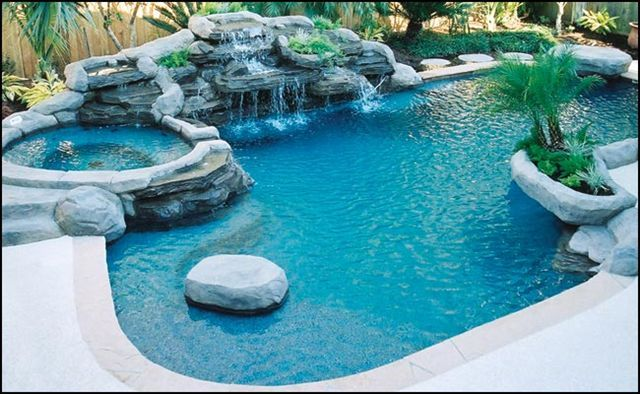 I love hot tubs attached to pools. All this needs is a slide.