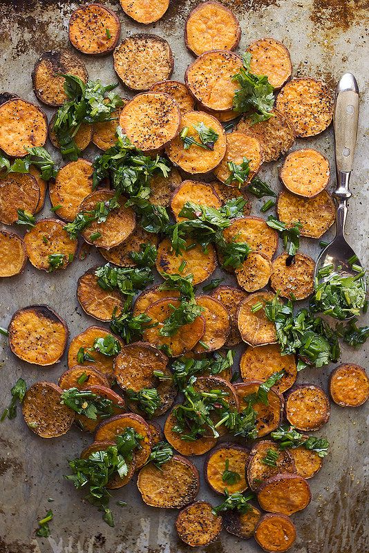A simple side-dish perfect with nearly every meal & just a few ingredients // Roasted Sweet Potato Rounds with Garlic Infused Olive Oil and Fresh Herbs // @tastyyummies // www.tasty-yummies.com