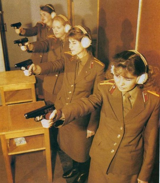 Soviet female cadets of the Medical Corps practicing shooting.