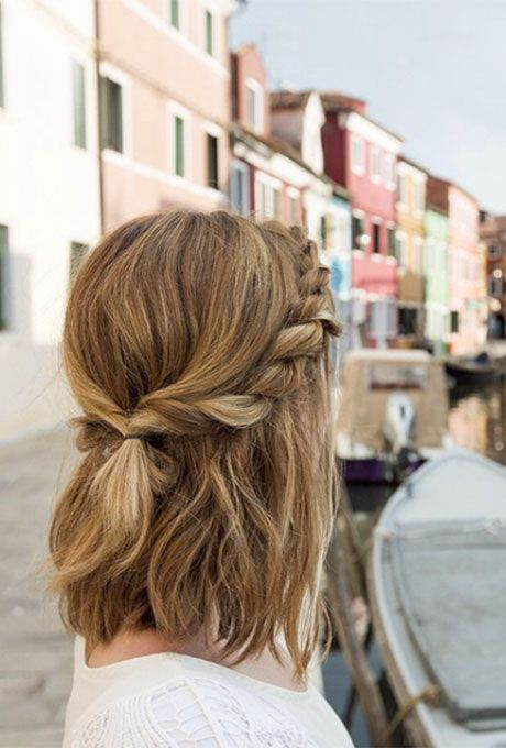 """If you have some dry shampoo lying around, you can pull off this aisle-worthy half-updo in 10 minutes flat. Blast second-day hair with a volumizing dry shampoo, like Bumble & Bumble Thickening Dryspun Finish. Separate your hair into two sections and create a two-strand braid on one side """"A two-strand braid is almost the same idea as a French braid, except you're using two pieces,"""" says Potempa. """"Take the right section under the left so they switch places and add a small piec"""
