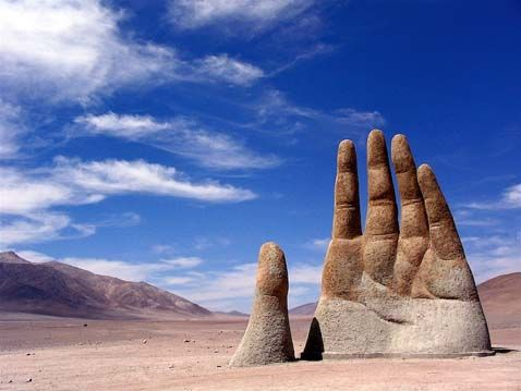 Deep in the the Atacama desert in Chile emerges a giant sculpture of a hand. A popular photo spot for tourist visiting the Atacama. The hand was constructed at an altitude of 1,100 meters above sea level. The work has a base of iron and cement, and stands 11 meters tall. The sculpture was inaugurated on March 28, 1992. The sculpture is located about 70 kilometers to the south of Antofagasta, Chile. The artist behind Mano de Desierto, Mario Irarrázabal.