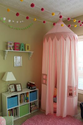Playroom Reading Nook... Love the words on the shelf! Joann Fabrics paper mâché painted in primary colors.