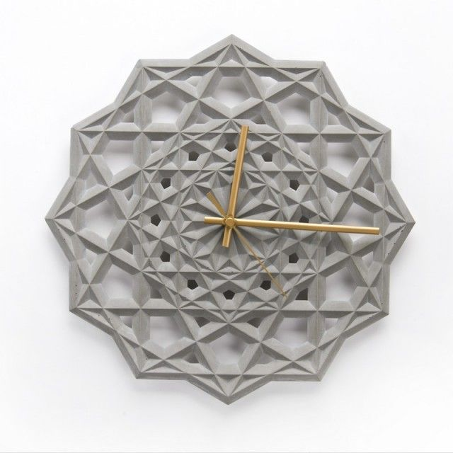 Concrete Geometric Wall Clock –The clock is inspired by Islamic patterns : an object which mixes the aesthetics and the utility with its geometric shape in concrete and its golden hand.