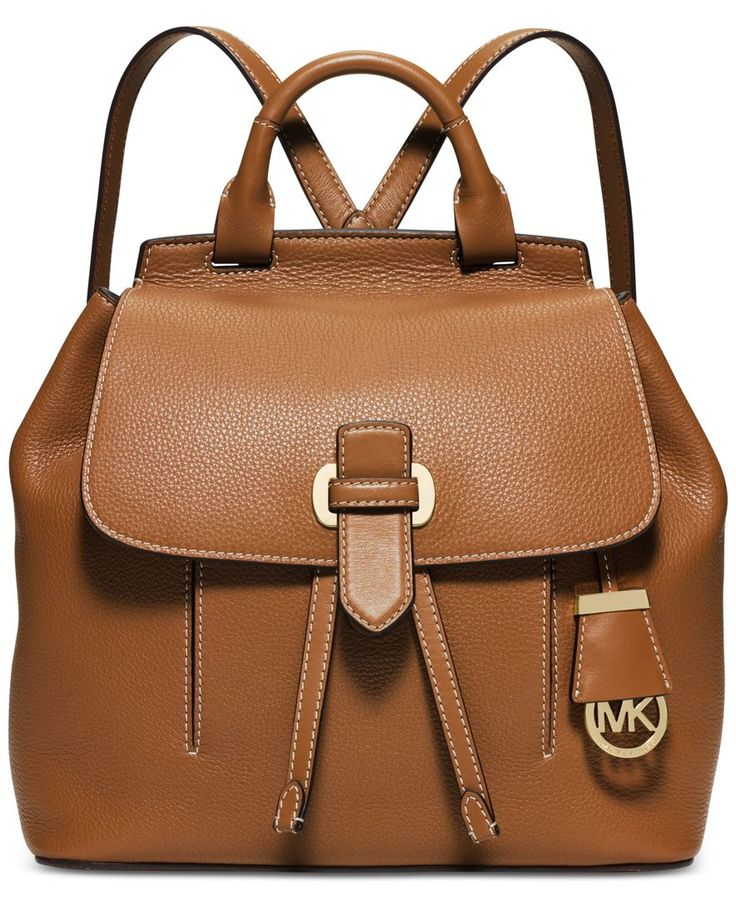 A perfect union of classic good looks and throwback style, the Romy Medium Backpack from Michael Michael Kors comes elegantly crafted in luxe pebble leather with slender, adjustable straps. | Small pe