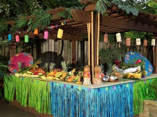 decorated table for backyard luau can be used for bar or food set up tropical party decorationsparty