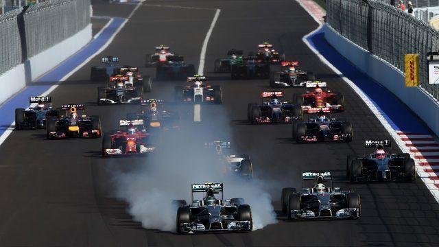 Lewis Hamilton (GBR) Mercedes AMG F1 W05 and Nico Rosberg (GER) Mercedes AMG F1 W05 locks up at the start of the race. Formula One World Championship, Rd16, Russian Grand Prix, Race, Sochi Autodrom, Sochi, Krasnodar Krai, Russia, Sunday 12 October 2014. BEST IMAGE