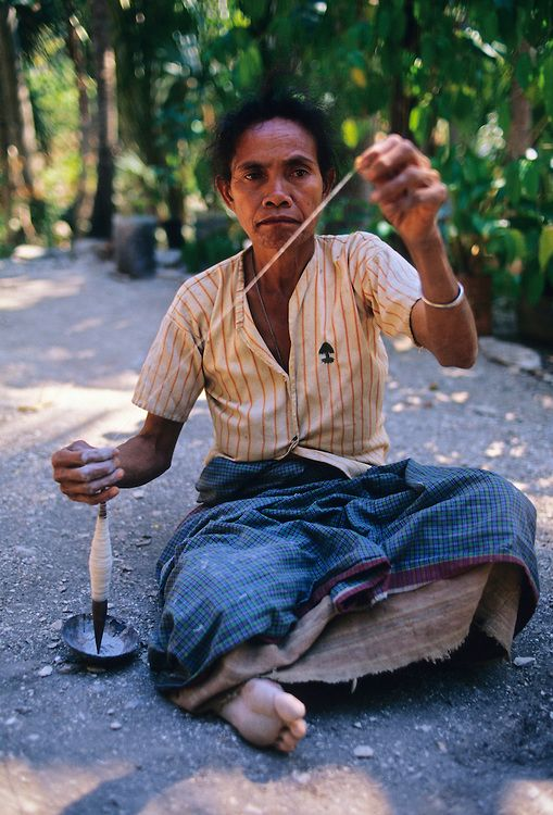 Boti spinner.  A woman spins thread which will later be woven into ikat cloth.