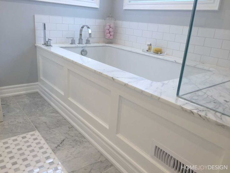 HOME JOY DESIGN | Master bathroom with marble and tub moulding