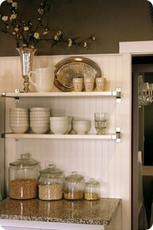 Wall extension above counter/island.  Creates division of space and shelving.  Hmmmm.