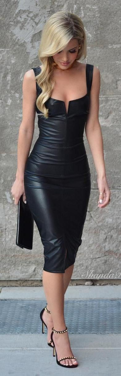 she is beautiful from head to sexy toes!! love her hot leather dress & strappy heels!