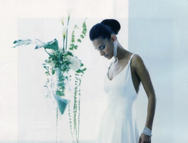 Elegant flower arrangement in a gigantic champaign glass vase for a Bridal gown photo shoot by Vincent Fleuriste