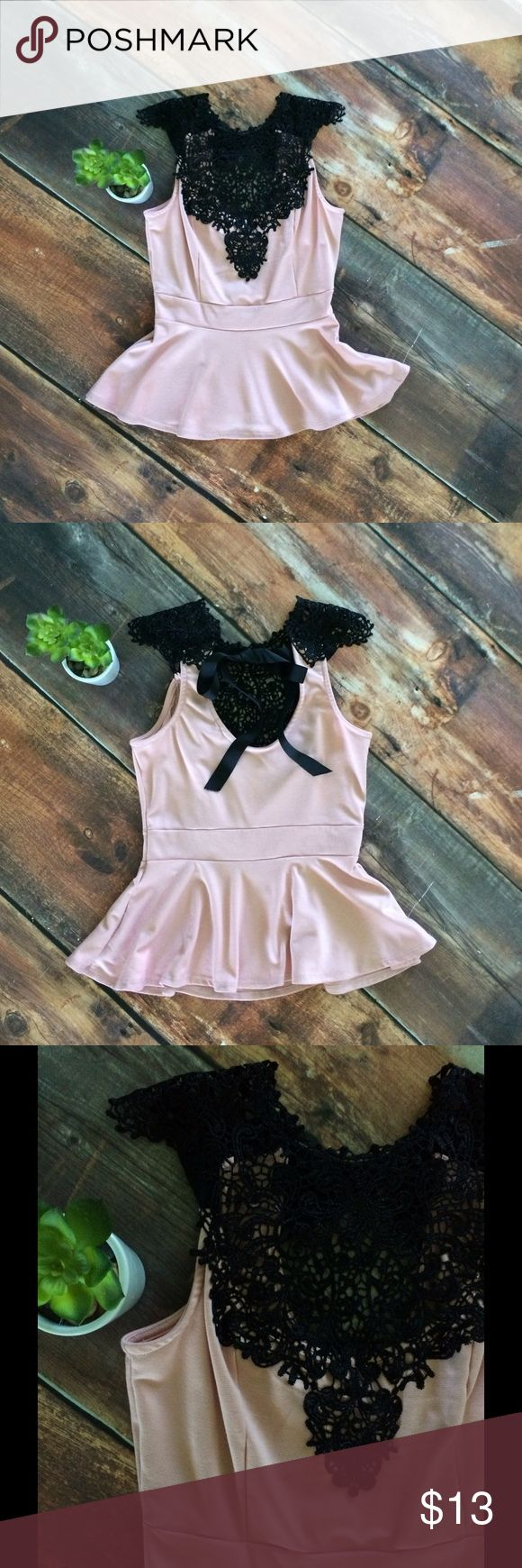 Lace embroidered blush and black peplum top Beautiful sleeveless light pink blush and black lace peplum top with gorgeous detail bow back. julie's closet Tops