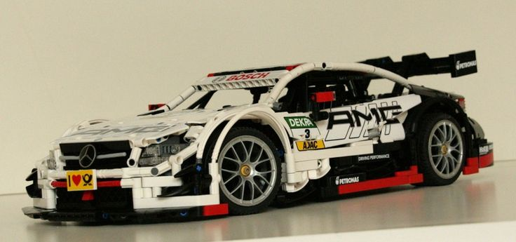 This stunning Mercedes-Benz AMG C63 DTM racing car was discovered on Eurobricks, and it's one of the most original Technic Supercars we've published in ages. Underneath the brilliant bo…