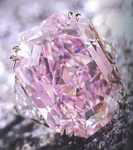 The pink diamond is the worlds most expensive diamond @ 11 million with 5 carats &  two white diamonds on either side. Pink diamonds are considered the most rare and generally found only in lower carat weights.