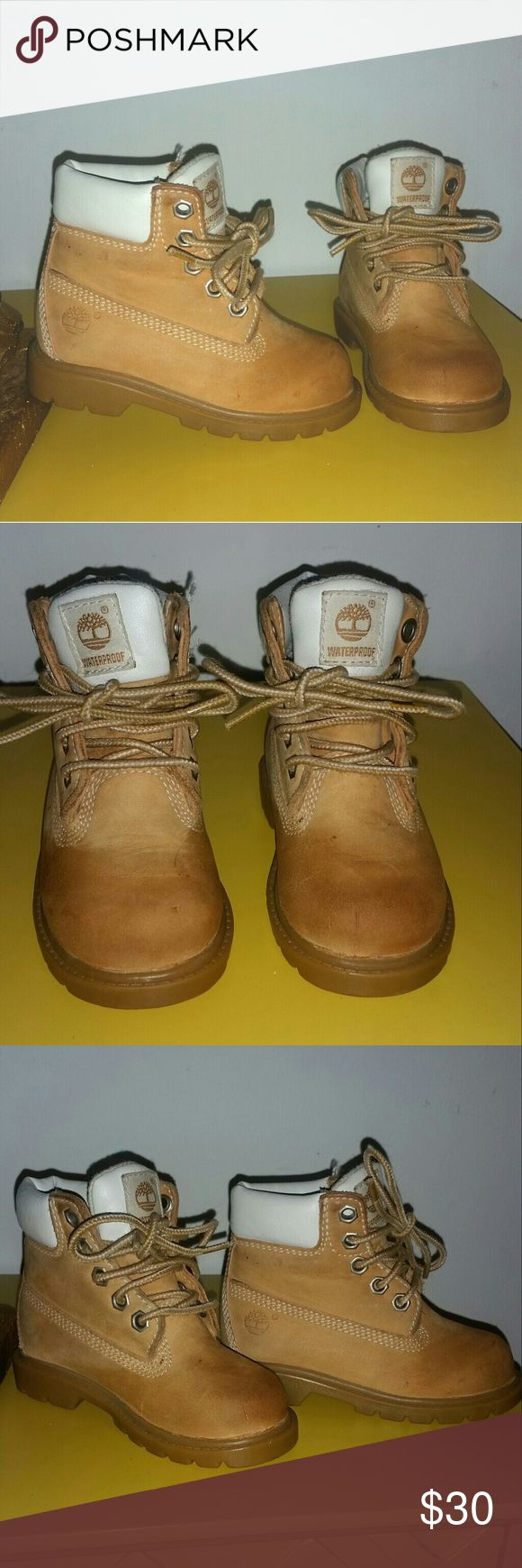 TODDLER BOYS TIMBERLAND BOOTS - SIZE 7 TIMBERLAND BOOTS FOR TODDLER BOYS - SIZE 7 ( TODDLER) ...THESE BOOTS ARE PRE LOVED AND IN GREAT CONDITION AND DOES SHOW SIGNS OF WEAR ON THE EXTERIOR OF BOOTS...WHICH ARE MINOR SCUFFS ON THE FRONT OF BOOTS...  MATERIALS CONSIST OF GENUINE LEATHER UPPER, MANMADE COLLAR, LININGS AND OUTSOLE Timberland Shoes Boots