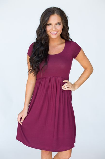 Shop our Short Sleeve Empire Waist Dress. Solid color dress available in…