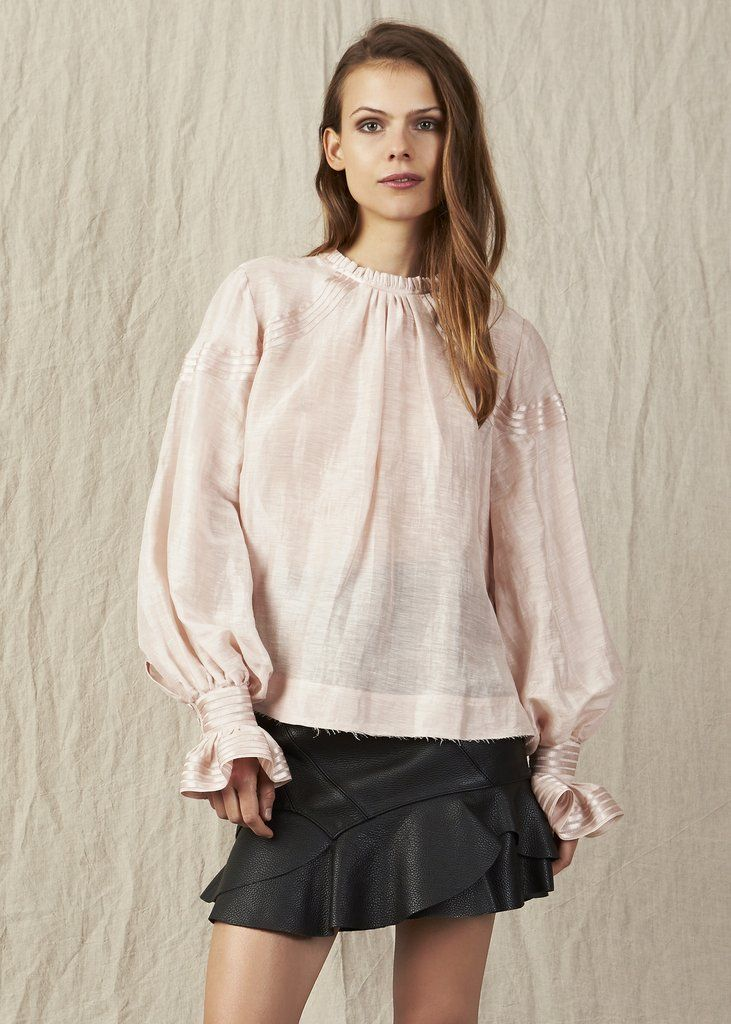 DESCRIPTION + The Tamarics Blouse is a relaxed fitting top with a high neck, bell sleeves and ruffled edging. SIZE...