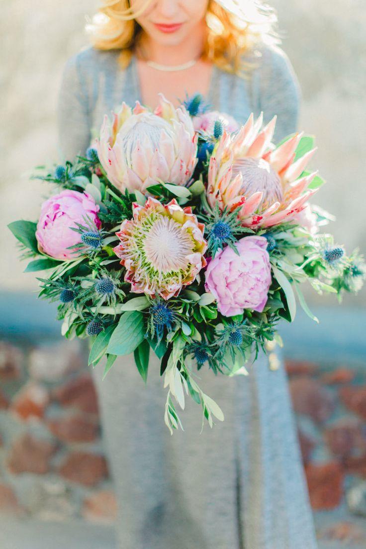 Floral Design: Betty Flowers Santorini - http://www.stylemepretty.com/portfolio/betty-flowers-santorini Photography: Anna Roussos - www.annaroussos.com   Read More on SMP: http://www.stylemepretty.com/destination-weddings/2016/07/20/santorini-vendors-kick-off-wedding-season/