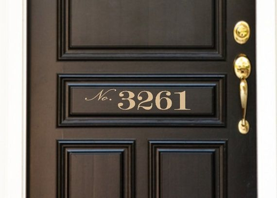 Love the black door with gold numbers.:
