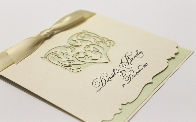 Folding invitation with laser cut heart and edging detail.    www.facebook.com/RubyGreyCreative