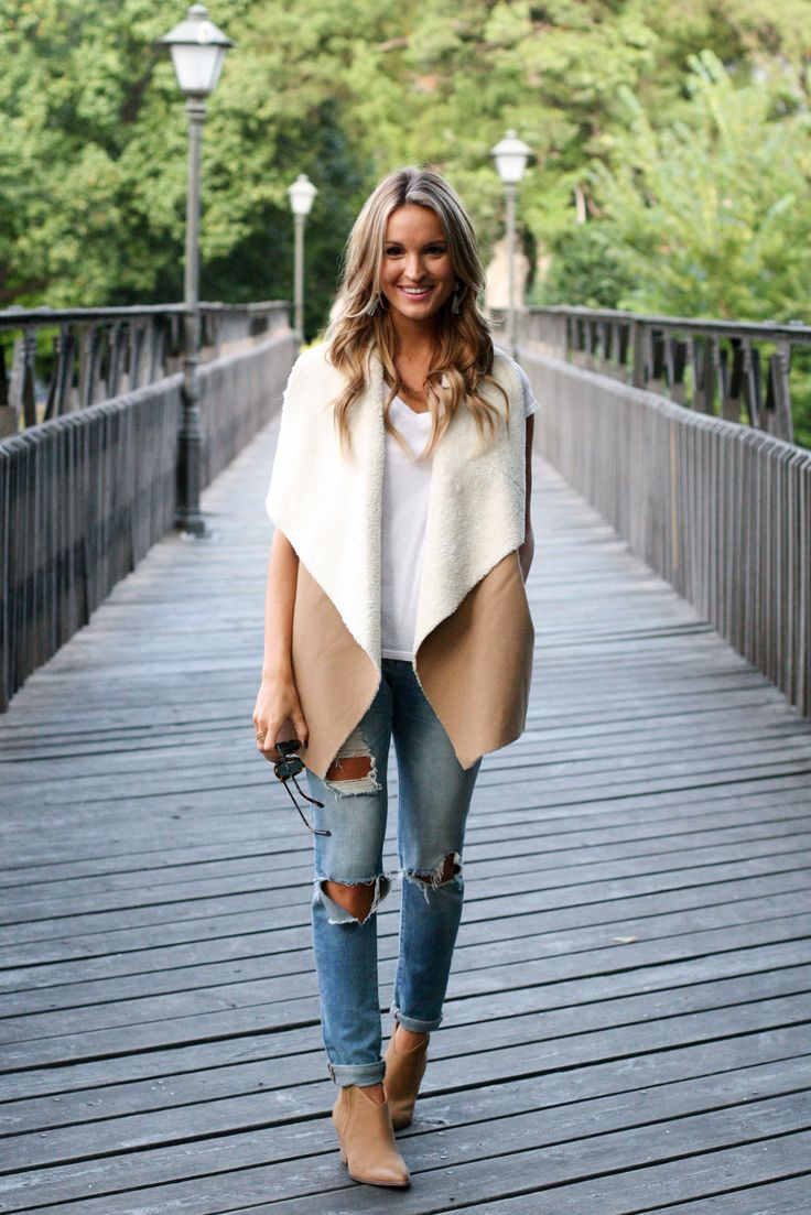Pair an oversized vest with slim fitting boyfriend jeans for a casual, on-trend look for fall.