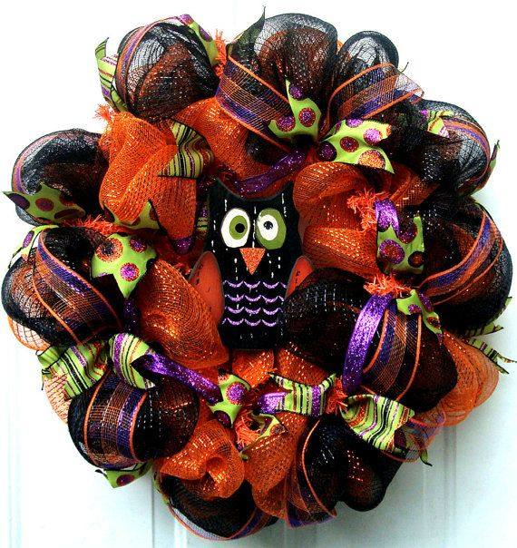 This is a fun whimsical fall wreath that will look great on your front door or anywhere you would like to add a special touch of fall to your home. The colors in this wreath consist of metallic sage green, orange, black and purple. This wreath will give a shimmer and sparkle when the sun shines on it. I have added various sized wired ribbon that coordinates beautifully with the deco mesh. To add a whimsical touch, I have added an adoreable owl to the center of the wreath. This wreath…
