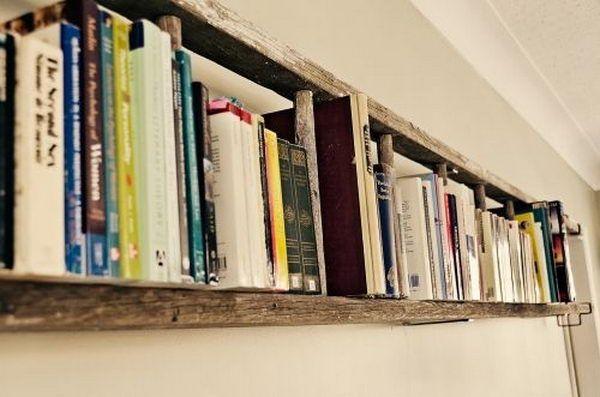 Hamg a ladder horizontally on the wall as a book shelf.