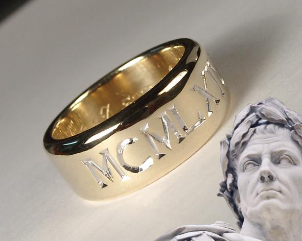 Roman numerals year of marriage engraved on outside of ring.