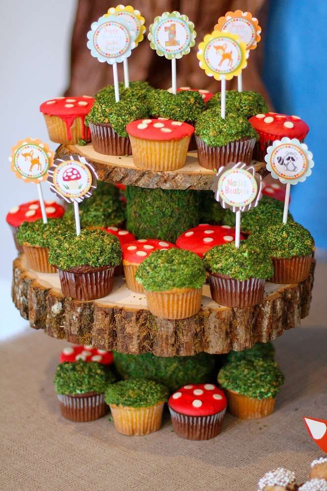 Rustic cupcakes at a woodland forest birthday part…