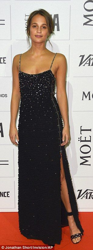 ady in black: Swedish actress Alicia Vikander showed some leg in a black dress with side split
